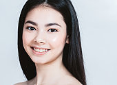 Beauty Asian Woman face Portrait. Beautiful Spa model Girl with Perfect Fresh Clean Skin. Female smiling. Youth and Skin Care Concept.