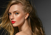 Curly long hair blonde young model. Beauty girl with curly perfect hairstyle.