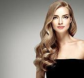 Amazing woman portrait. Beautiful girl with long wavy hair