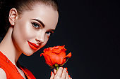 Beauty woman with rose flower beautiful curly hair and lips