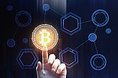 Hand pointing at bitcoin