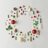 Christmas decoration wreath made of various winter and holiday objects.