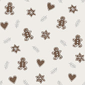 Cute Christmas seamless pattern with various gingerbread cookies and fir tree branches . Winter food concept. Hand drawn flat vintage design. Vector illustration background.