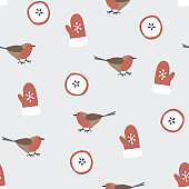 Cute festive winter seamless pattern with hand drawn finch birds, sliced apples and gloves. Christmas design. Vector illustration