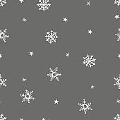 Simple grey festive seamless pattern with hand drawn white snowflakes. Christmas winter design. With falling snow. Vector illustration background.