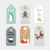 Vintage Christmas gift tags set. Hand drawn labels with winter flowers, fruit, pudding, penguin bird, gingerbread cookie and house. Isolated vector illustration objects.