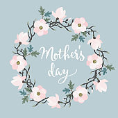 Mothers day greeting card, invitation. Brush script, calligraphic design. Floral wreath made of oak leaves and magnolia flowers. Stock vector illustration