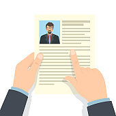 Recruitment concept. Hands hold CV profile
