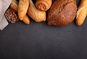 white, gray and rye bread, baguette, roll with sesame seeds