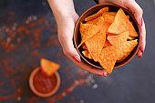 homemade tortilla nacho chips hold bowl hands