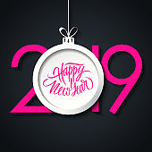 2019 New Year greeting card with hand lettering holiday greetings Happy New Year and christmas ball. Pink color.