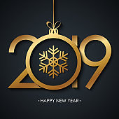 2019 Happy New Year greeting card with golden christmas ball and snowflake on black background.