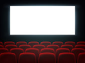 Cinema hall with white blank screen and chairs