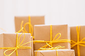 present selection gift box craft paper yellow bow