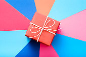 red gift box colorful background present reward