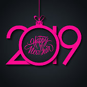 2019 New Year greeting card with hand drawn lettering Happy New Year and pink christmas ball.