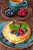 Dessert plate with pancakes and fresh berries
