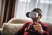 Senior man uses VR glasses