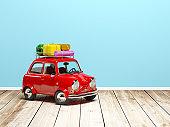 small retro travel car on floor