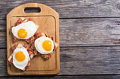 toast with bacon and fried eggs