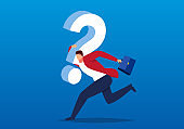 Businessman carrying a huge question mark to find ways to solve the problem, the concept of business difficulties