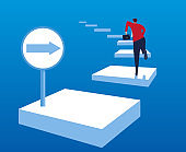 businessman ran to the finish line along the street signs