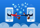 Two businessmen fly out of their mobile phones and shake hands