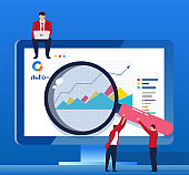 Analyze data with a magnifying glass in front of the computer screen