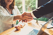 Handshake of business office partnership businesspeople shaking hands colleagues and greeting join in working place collaboration meeting concept