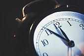 Five minutes to midnight on retro analog clock