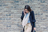 Fashionable business woman talking on a phone outdoors