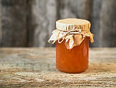 Close up of brown jam on wooden rustic background