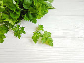 fresh parsley bunches on a white wooden background