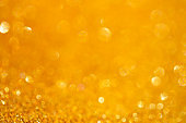 Gold bokeh background, abstract with defocused lights.