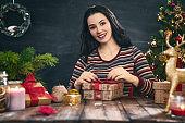 woman preparing a Christmas present