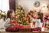 Girl opening Christmas gifts