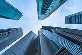 Low angle view of modern metallic skyscrapers