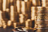 Golden coin stacks, rich money background
