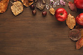 Vintage autumn border from apples and leaves on wooden table