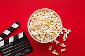 Clapperboard popcorn on red background
