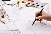 Architect drawing architectural project closeup