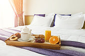 Breakfast served in bed on wooden tray