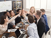 Successful business team is giving high five