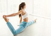 Plastic female dancer doing splits at gym center