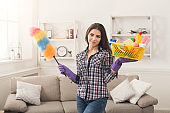 Woman with cleaning equipment ready to clean room