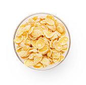 Bowl full of corn flakes on white background