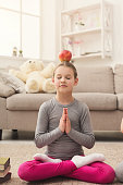 Little girl training yoga together indoors