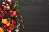 Fresh organic vegetables on wood background.