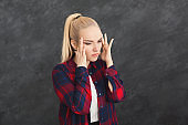 Emotional stressed woman with headache portrait