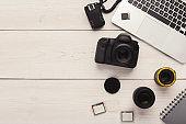Photo camera, lens and memory card at computer
